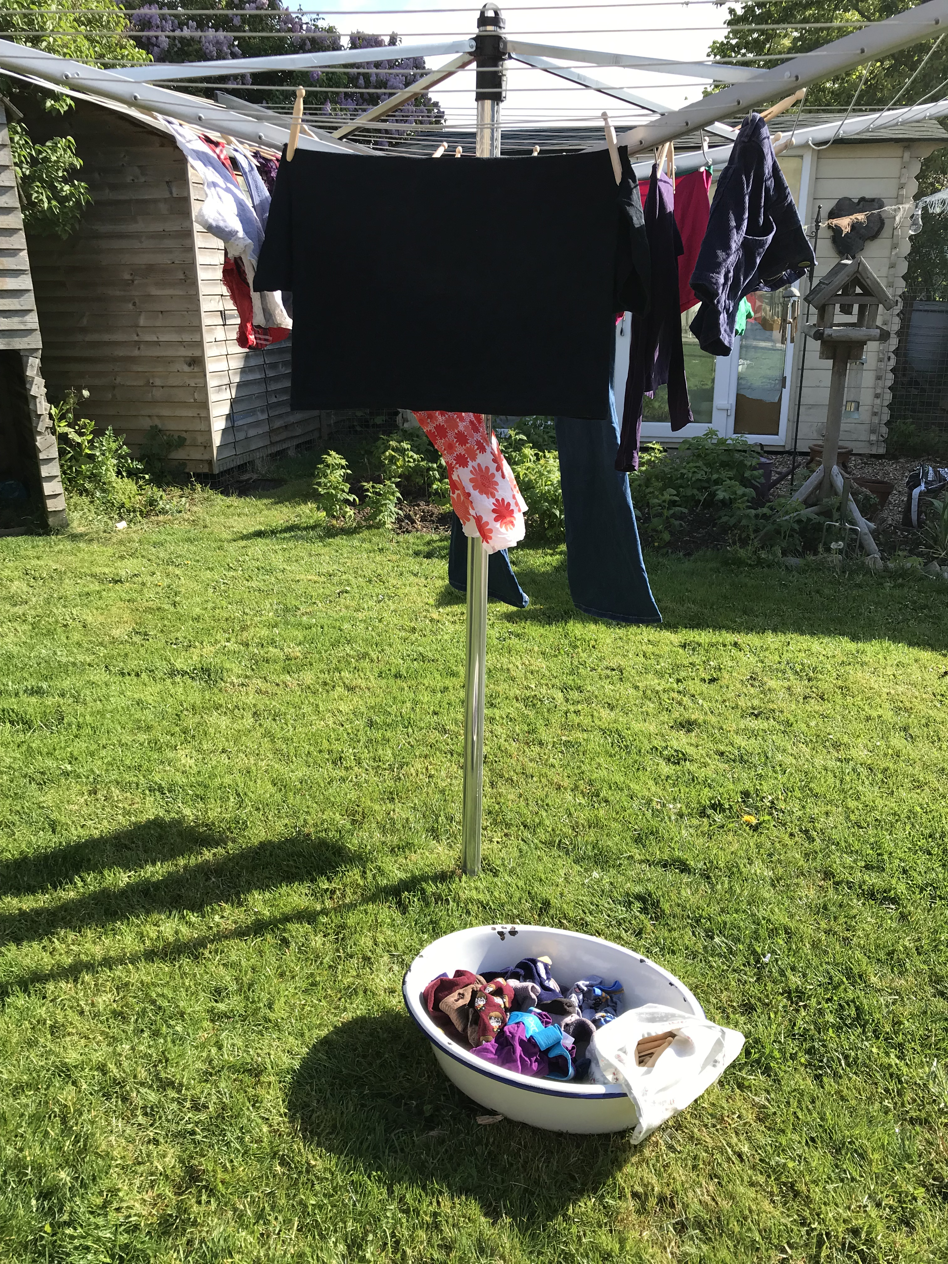 Handmade haven laundry day using enamel baby bath which was my nans baby bath, wooden pegs in a handmade peg bag.